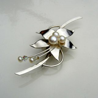 Sally Brown - Silver floral brooch A brooch made in sterling silver and set with freshwater pearls and crystal beads